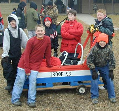 Scouts and their sled on wheels, ready to roll!